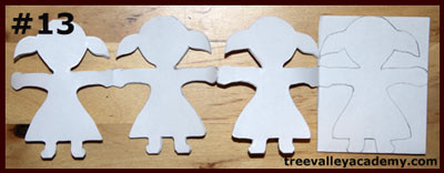 Cutting out one layer at a time of a 4 row 4 column paper doll chain. A fun art project to do with kids.