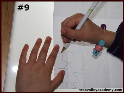 A step in making a 4 row 4 column paper doll chain. A fun art project to do with kids.