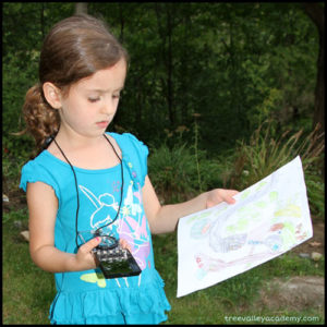 child learning to use a compass and read a map