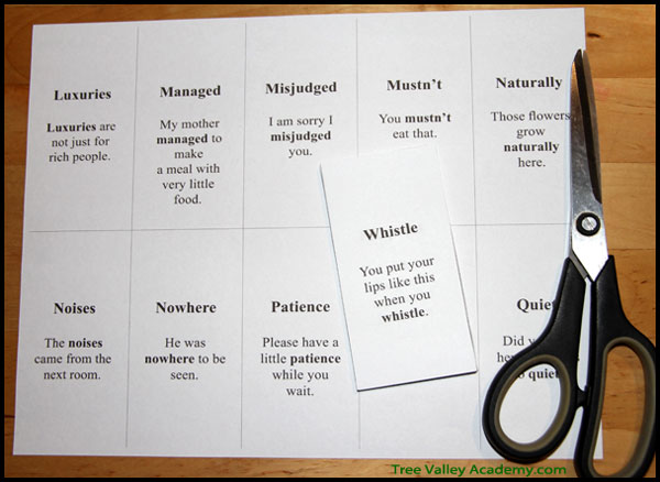 """Cutting up flashcards to review difficult sight words and vocabulary with 2nd or 3rd grader before reading the story. Review of """"The Magic Stories""""."""